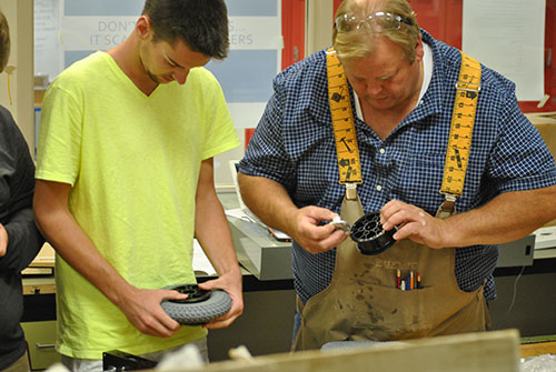 "Members    of robotics use other skills from classes like woodworking to help aid them while building.  ""I get to learn how to build all the mechanical systems in the robot. It's nice to build something new,"" senior Austin Sayre said."