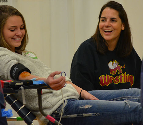 Senior Kaylin Williams talking to leadership adviser Sarah Green as she donates at the school blood drive on November 14.
