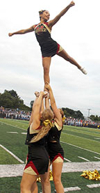 Tonka cheerleaders build formations at the first home football game on Aug. 21.