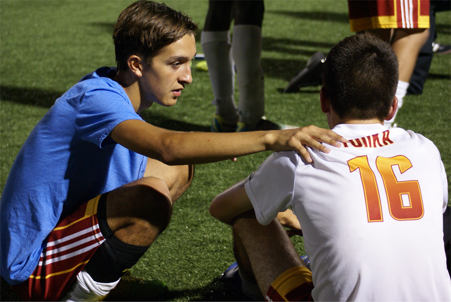 Senior Dominic Padilla encouraging his teammate senior Tyler Kalm after a soccer game on August 27.