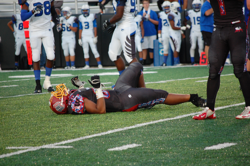 Senior Isaiah Hensley laying injured on the field after dislocating his ankle on September 11 against Raytown South.