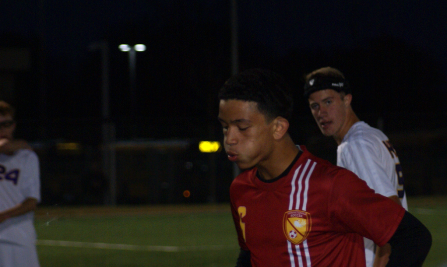 Senior Quinton Carter blowing off steam at the district soccer game on Oct. 26 at the DAC.