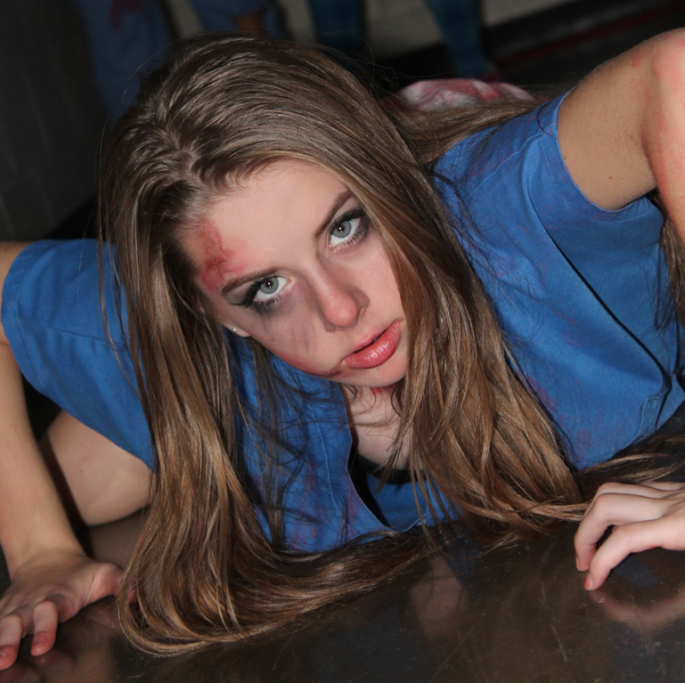Freshman Lana Moerer crawling across the floor throughout the Student Council Haunted House on Oct. 24.