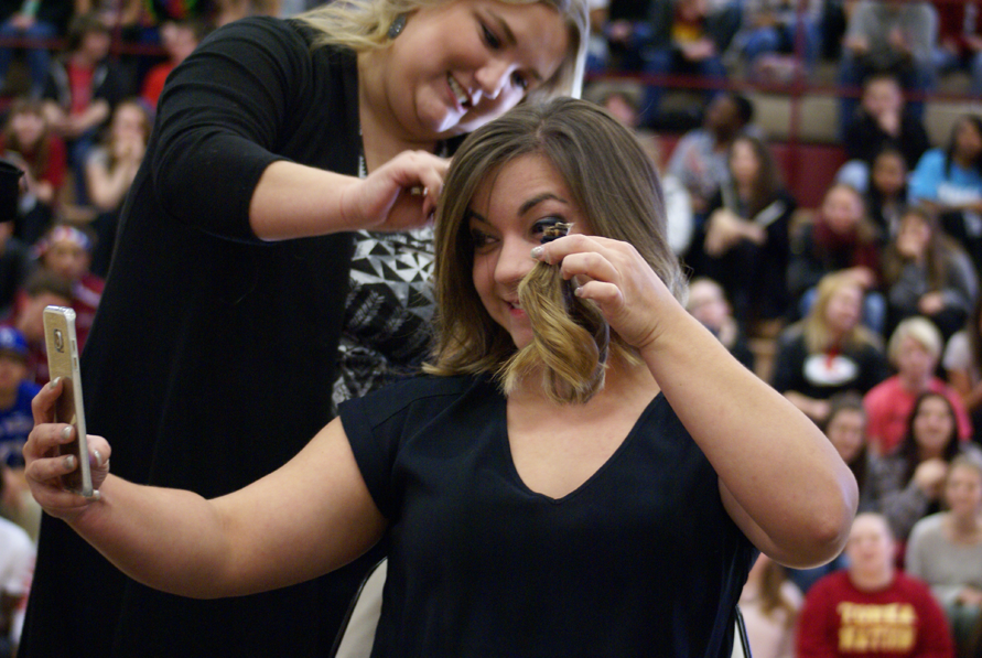 The amount of money that had to be raised for math teacher Ashley Carter to get her hair cut at the United Way assembly on November 24 was $35.27.