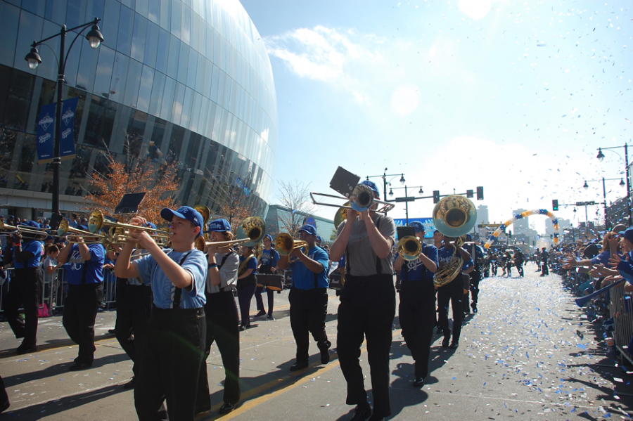 """Walking in the parade on Nov. 3, the band plays """"Don't Stop Believing"""" by Journey."""