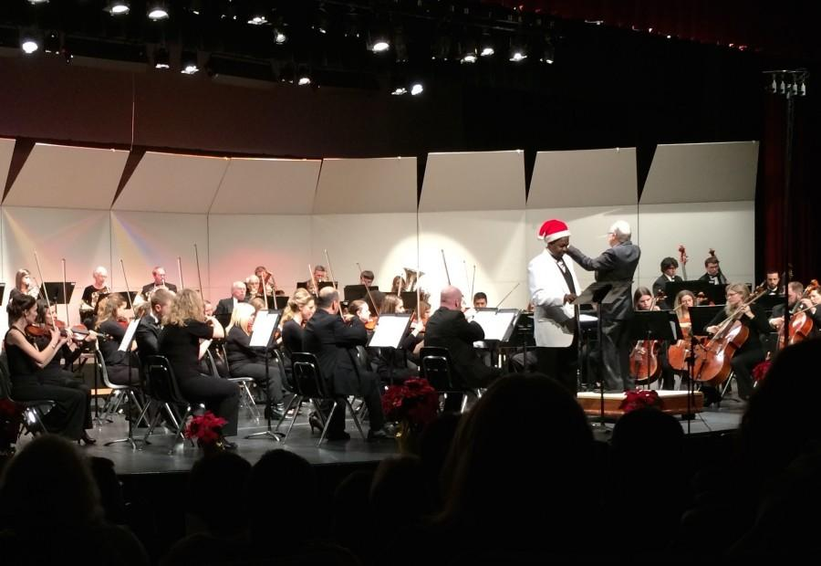 """KMBC Chief Meteorologist, and also Liberty Symphony Orchestra timpanist Brian Busby, narrating the story """"'Twas the Night Before Christmas"""" whilst the orchestra plays corresponding tunes behind him."""