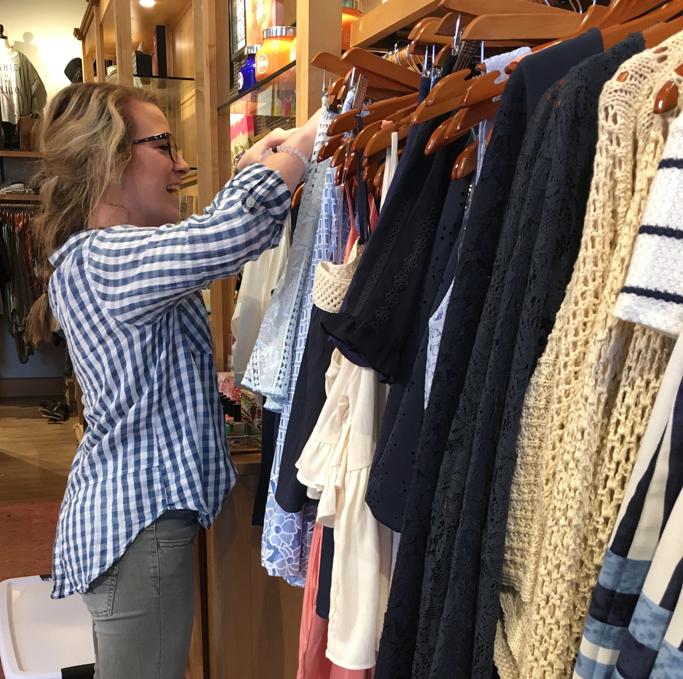 Senior+Haley+Swanigan+at+her+job+organizing+the+clothing+rack+on+March+3.