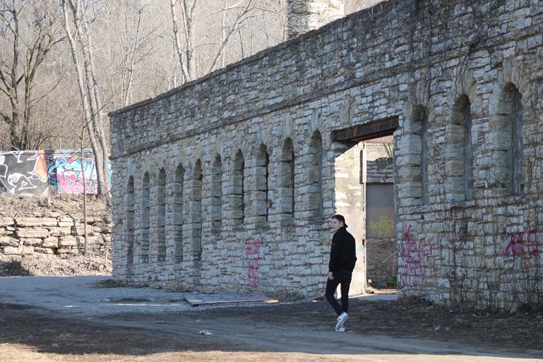 Senior Julian Niewiadomski walking towards the Kansas City Workshop building on Feb. 24.