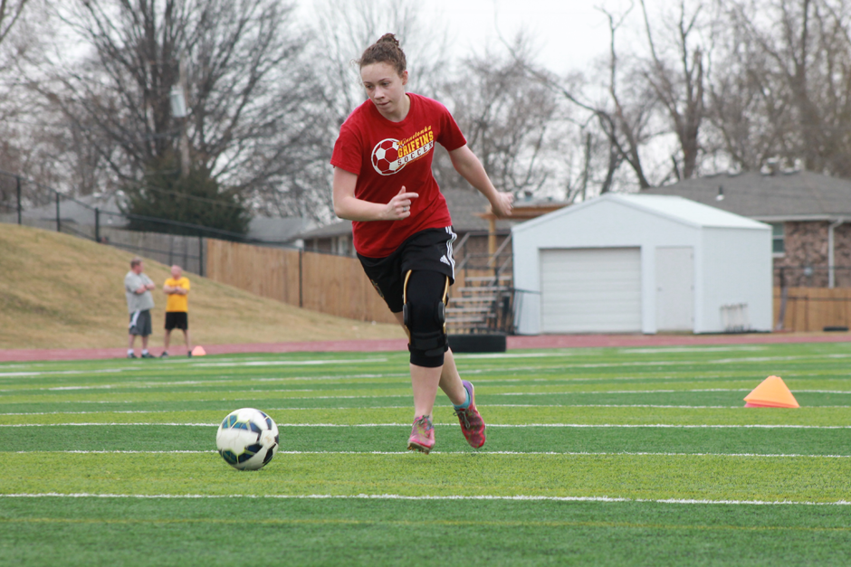 Senior Emily Glotfelty practicing her passes on March 7.