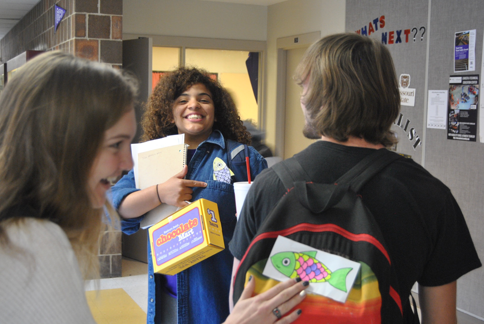 Senior Kiera Hall with a paper fish that stuck onto her by a French Club member on April 1. Senior Jordyn Eskijian putting a paper fish onto another students' back on April 1.