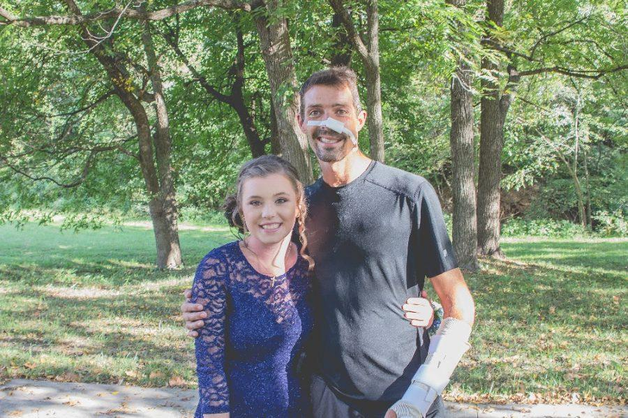 Sophomore Halle Clapham with her dad, Joshua Owen, after his heroic rescue of a woman in a local Walmart parking lot.