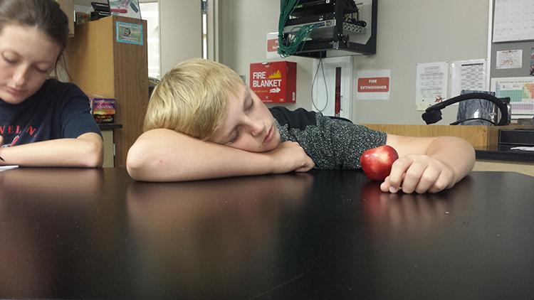 +In+class%2C+sophomore+Zach+Riley+gets+some+shuteye+on+October+17th.+Many+students+take+the+opportunity+to+sleep+during+school+in+which+they+can+miss+important+information.+