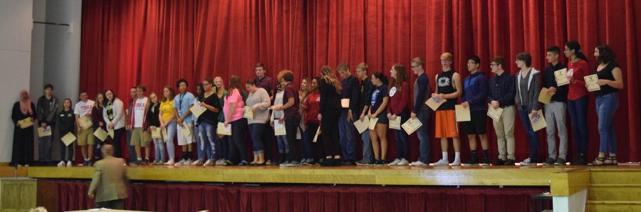 Juniors who obtained a 3.75+ GPA during the 2015-2016 school year aligned on the Winnetonka auditorium stage in order to receive their academic letters.