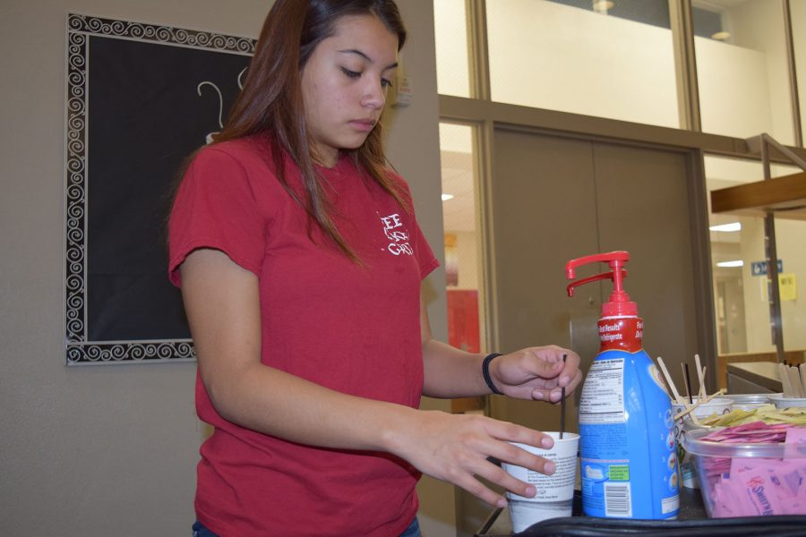 Sophomore Jordyn Turncheck at Griffin Grounds adding creamer to her coffee on Nov. 7.