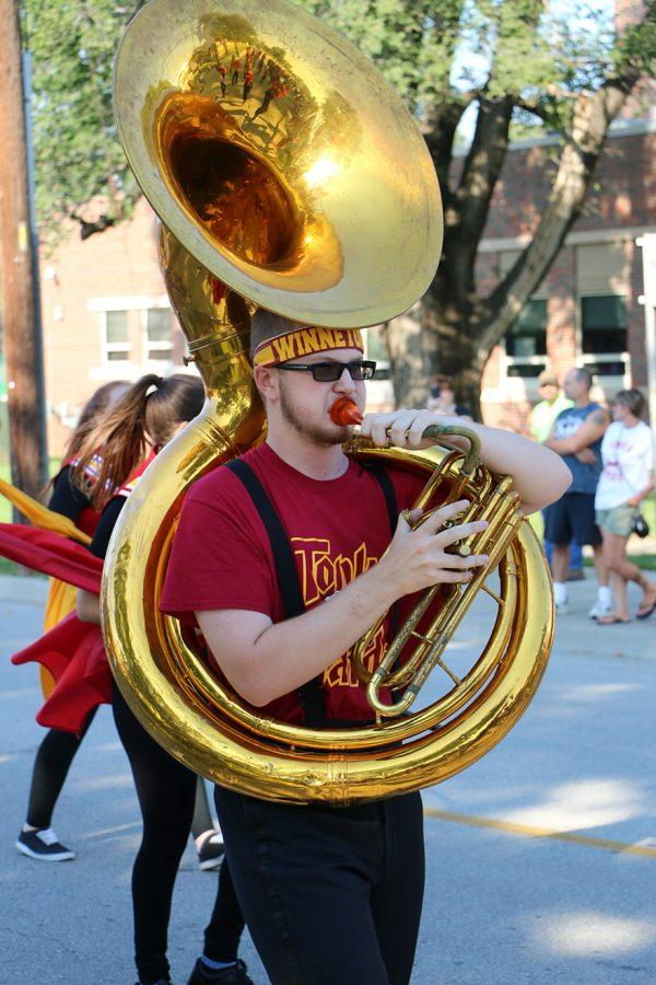 Junior Dillon Osborne playing the tuba in the homecoming parade on Sept. 23.