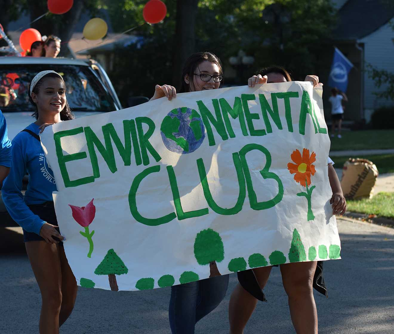 Senior Kaitlyn Minet and junior Kamilah Thomas-Walter in the homecoming parade on Sept. 23 representing the Environmental Club.