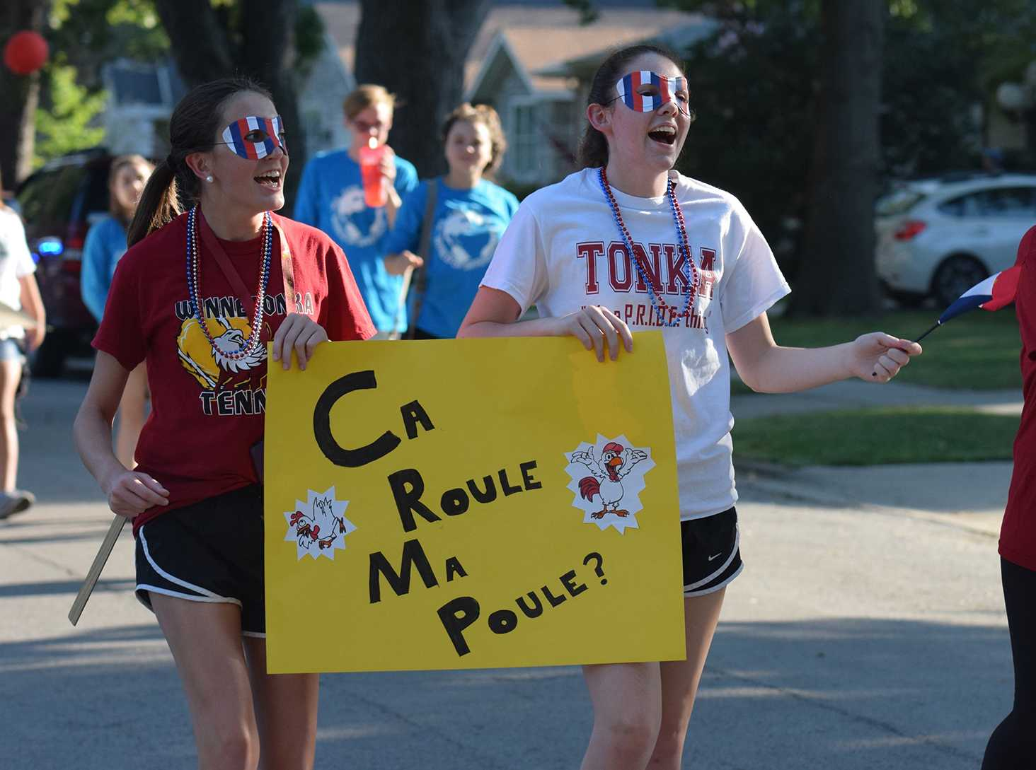 Sophomores Emma Jameson and Maggie Williams walking in the homecoming parade with the French Club on Sept. 23.