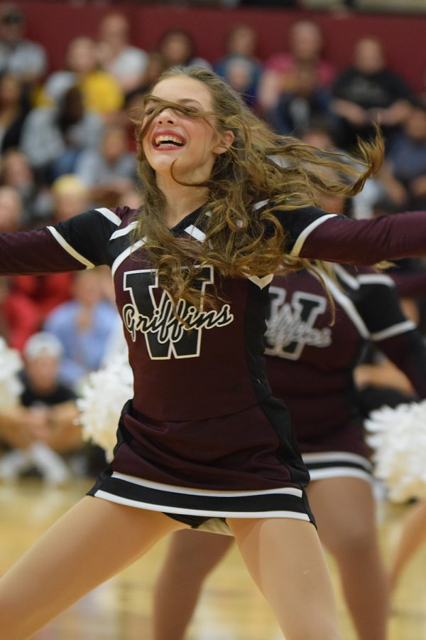 Freshman Halle Stamper performing a dance routine during the homecoming pep assembly on Sept. 23.