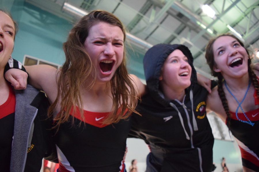 Sophomore Makayla Cambiano chants in the team huddle before prelims on Friday Feb. 3.