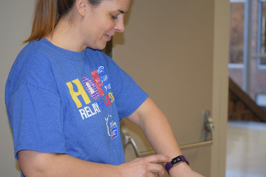 History teacher Sarah Green checks her step count on her Fitbit.