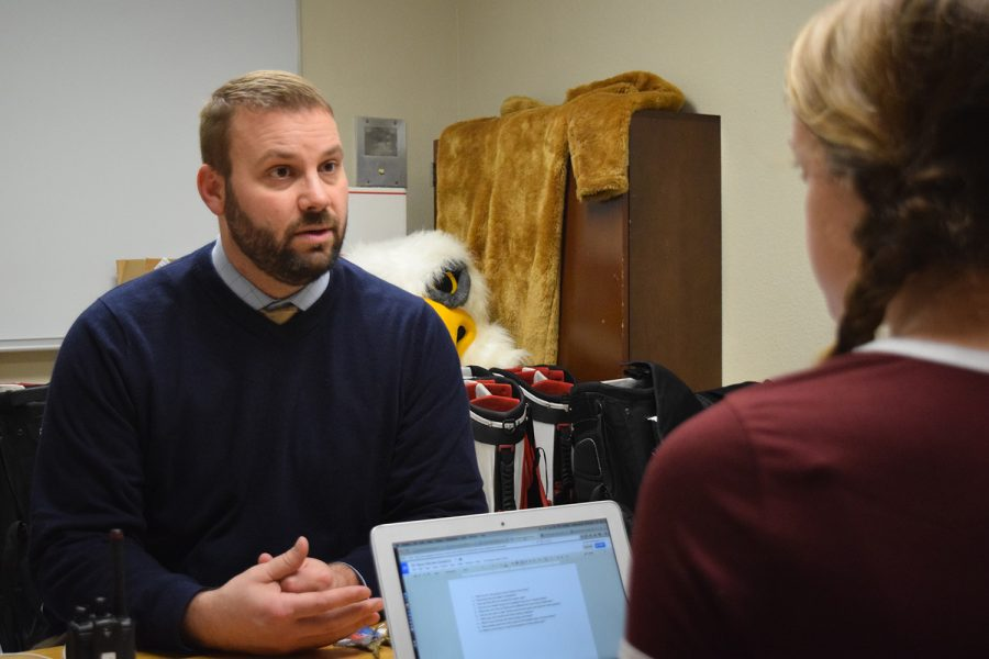 New Interim principal Mark Maus discusses transition with Griffin Rites staff writer sophomore Clayre Barkema on Jan. 27.