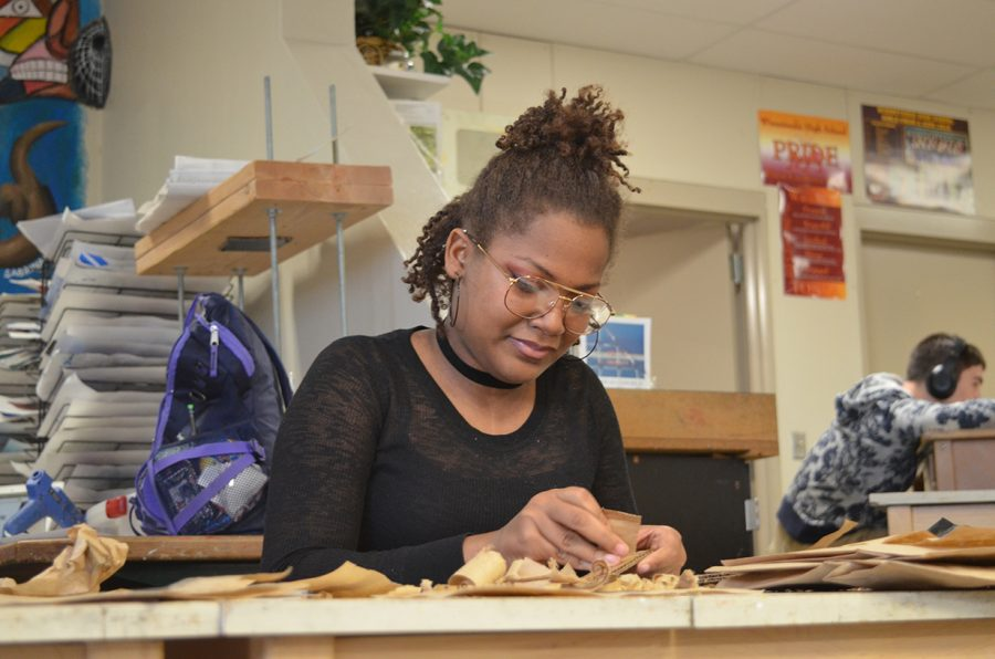 Senior Charity Smith works on her concentration piece for AP Studio Art.