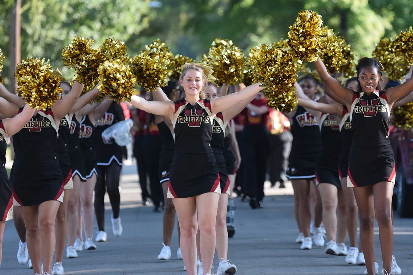 The cheer team walks in the homecoming parade on Sept. 23.