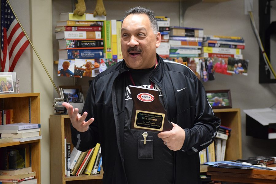 Head volleyball coach Mike Espinosa receives the Jarry Thomas High School Volleyball Co-Coach of the Year award from Greater Kansas City Officials Association on March 2.