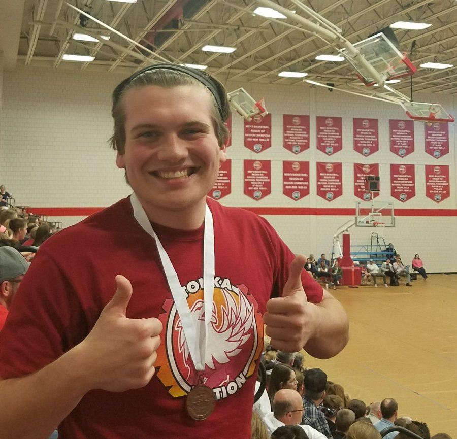 A thumbs up comes from junior Nate Blanton who is wearing his third place medal in Rocks and MInerals.