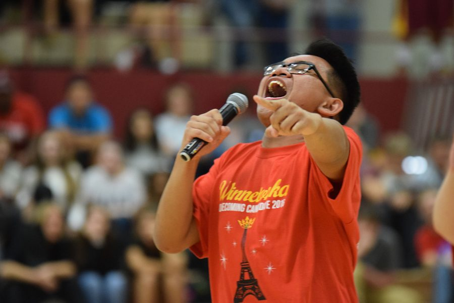 Sing along. Homecoming king candidate senior Eldridge Villegas sings along to a song during a pep assembly on Sept. 23 as the audience cheers him on in the main gym. Villegas is a theatre and choir standout who relishes time in front of an audience. Photo by Rachel Adamson.