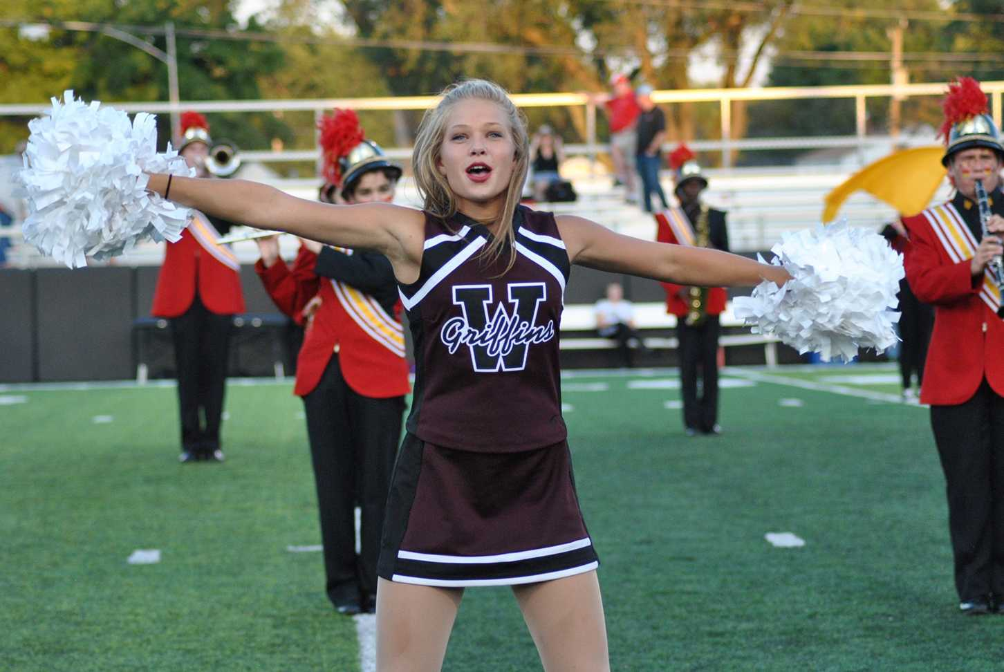 Sophomore Christine Harpe dances before the homecoming football game on Sept. 23.