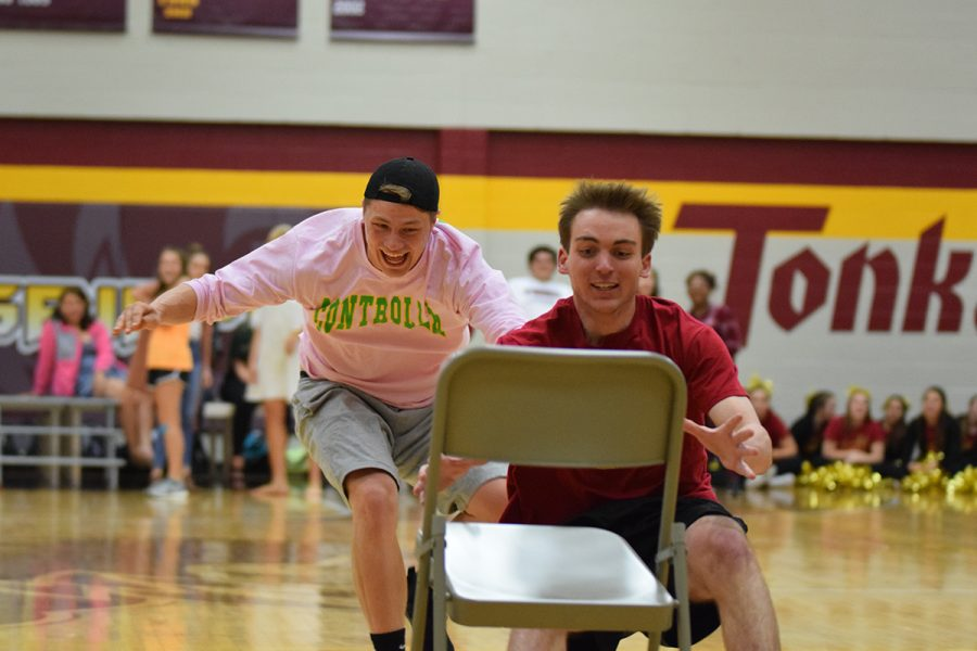 Senior Benjamin Giebler runs to grab the chair first with senior Ethan Beumer right behind him.