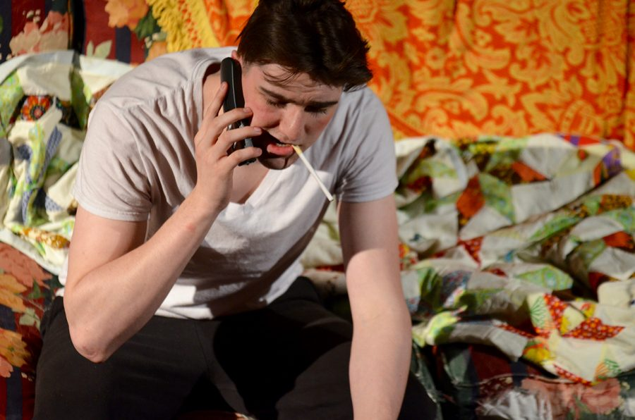 "unior Cameron Daniel in character as Clyde, talking on phone with his religious mother during dress rehearsal of ""Dearly Departed"" on April 4."