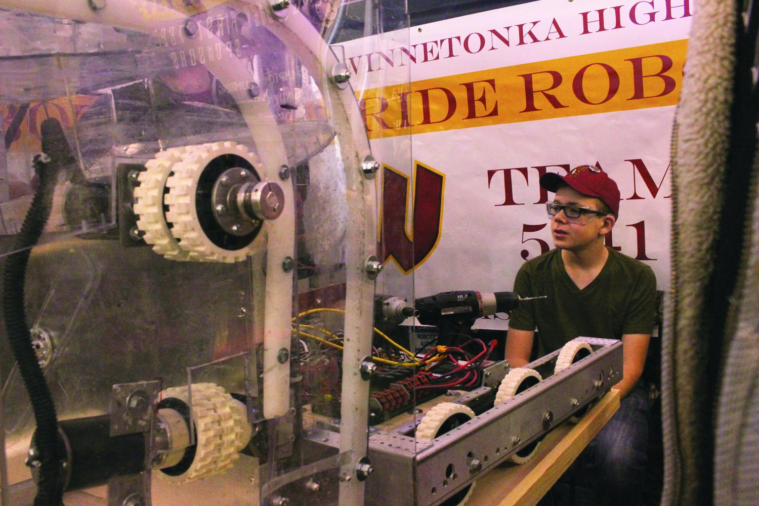 Freshman+Andrew+Willis+operates+machinery+at+the+robotics+competition+on+March+17.