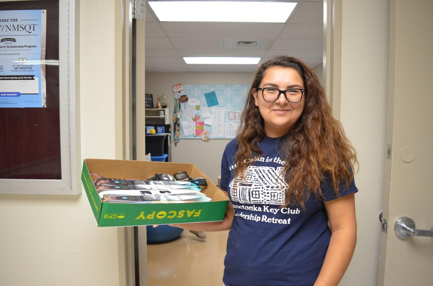 Senior Hannah Hernandez, the president of Key Club, holds a box with some the glasses collected.
