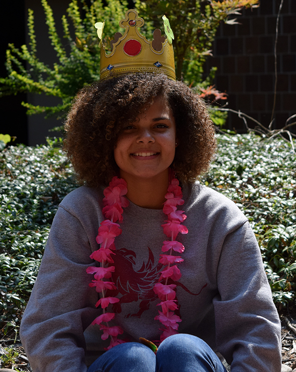 Heaven+Sanders+wears+a+pink+lei+after+being+announced+as+the+first+homecoming+court+member.