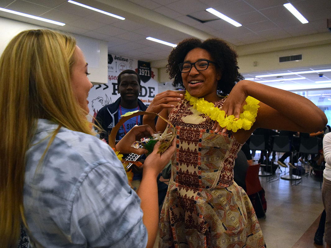 Senior Kashe Turner jumps up and down as she is given her lei after being announced as a member of the Homecoming court.