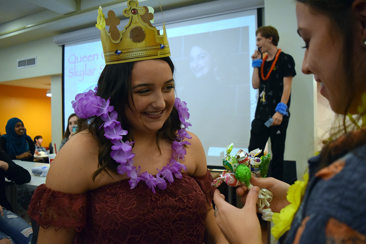 Senior+Skylar+Seitz+smiles+as+she+receives+suckers+after+being+announced+as+a+homecoming+queen+candidate.+