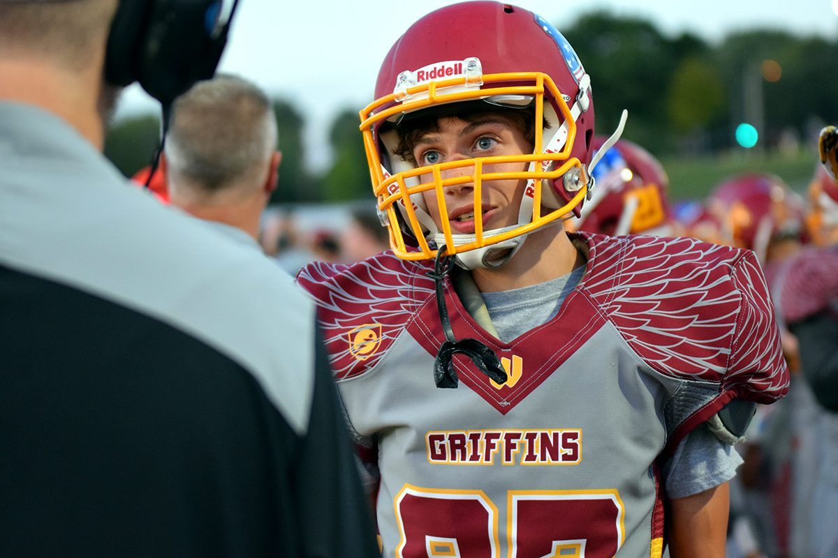 Senior+Hayden+Weathermen+talks+to+his+coach+after+attempting+a+field+goal+kick+in+the+first+ever+varsity+football+home+game+held+at+Tonka+on+Sept.+29.