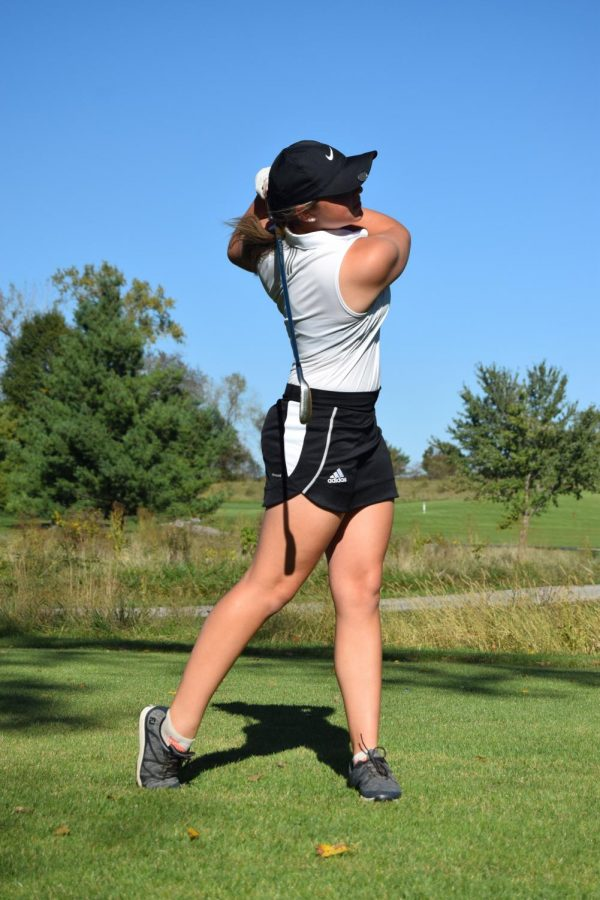 Junior Joelle Egeland follows through after a swing at practice on Oct. 18.