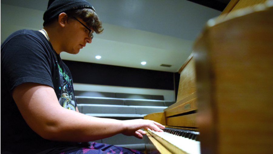 1. Junior Jacob Gustin plays the piano alone in the little theatre. Gustin enjoys the privacy that playing upstairs gives him, since he considers himself a shy person.