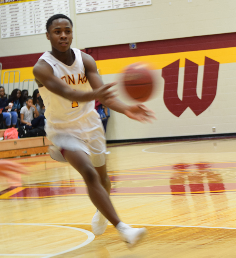 Junior Racine Williams III passes the ball to a teamate during the Dec. 5 game against Staley.