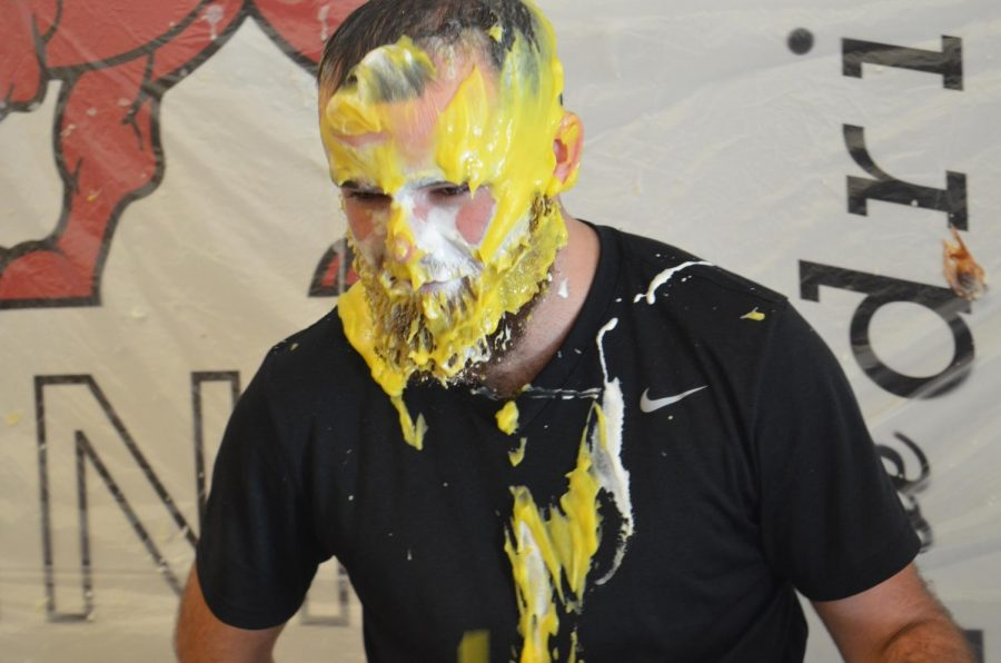 Math teacher Jared Buckman is pied in the face during second lunch on Dec. 18.