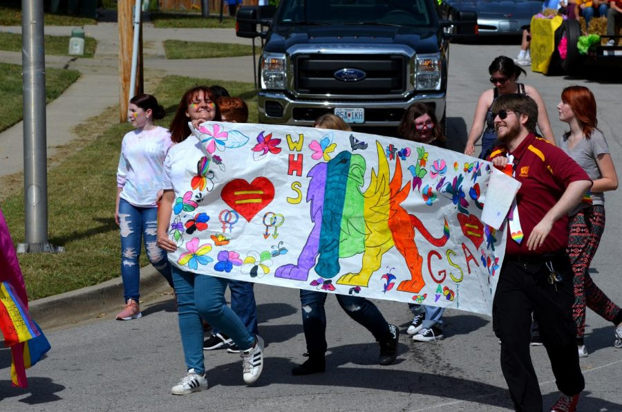 Junior Regan SmithMcLey and English teacher James Hawes walk with Gay-Straight Alliance in the homecoming parade on Sept. 29.