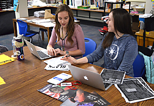 J2 Multimedia Editor-in-Chief Katie Bullock & Print Editor Jessica Glaszczak discuss Griffin Rites page edits during class on Jan. 18.