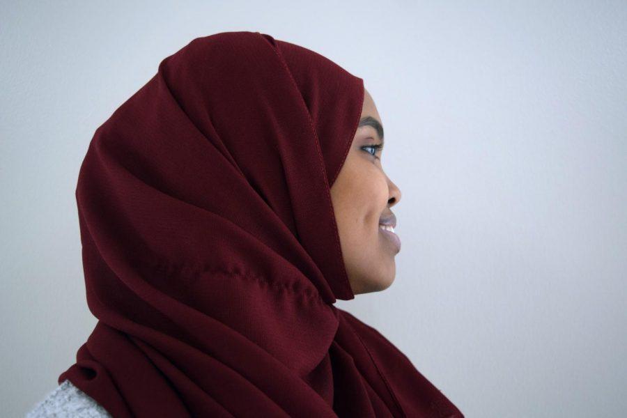 Senior Arfon Abdi, the president of the Muslim Student Association, wears her hijab proudly.