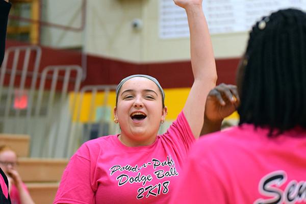 Senior Skylar Seitz pumps her fist in the air after winning a match of the Powder Puff Dodgeball tournament on Jan. 26.