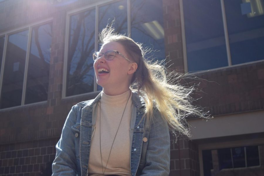 Senior Danielle Dodd laughs in the courtyard. Dodd will be attending the University of North Carolina School of the Arts this coming fall to study lighting design.