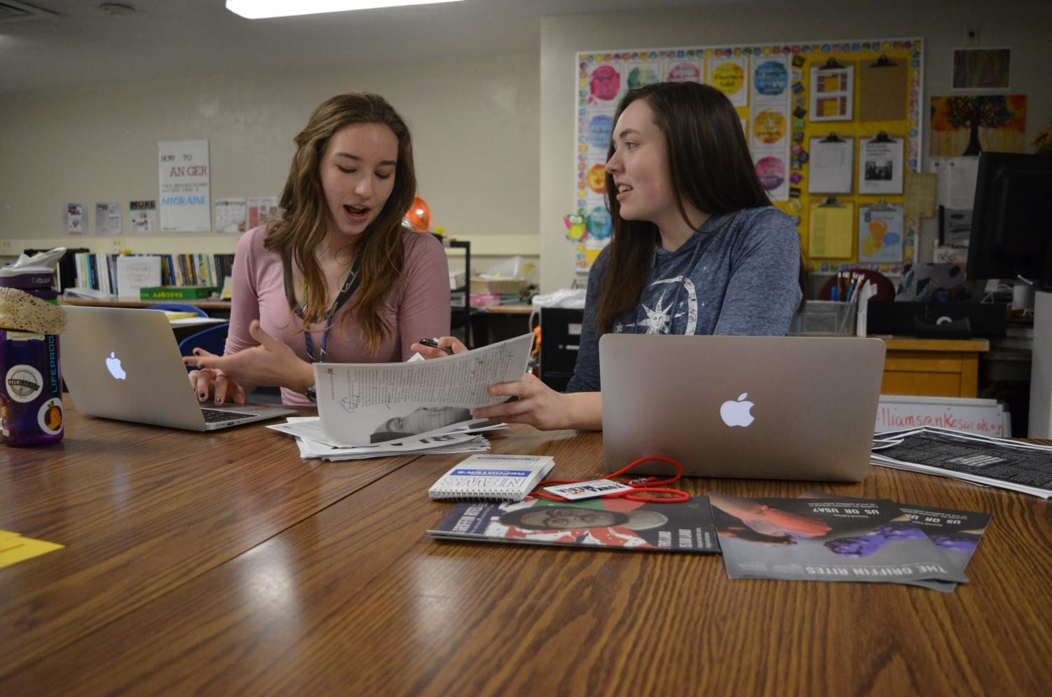 Griffin Rites editor-in-chief junior Katie Bullock, left, works with print managing editor Jessica Glaszczak on an upcoming issue of the newsmagazine. Bullock was selected to the All-State Journalism team on May 4.