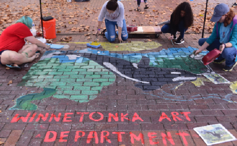Photo to the right: Winnetonka art students paint in an orca on the sidewalk at Crown Center. Last school year, art students chose this image to recreate at the  September festival. Photo by Elizabeth Payton